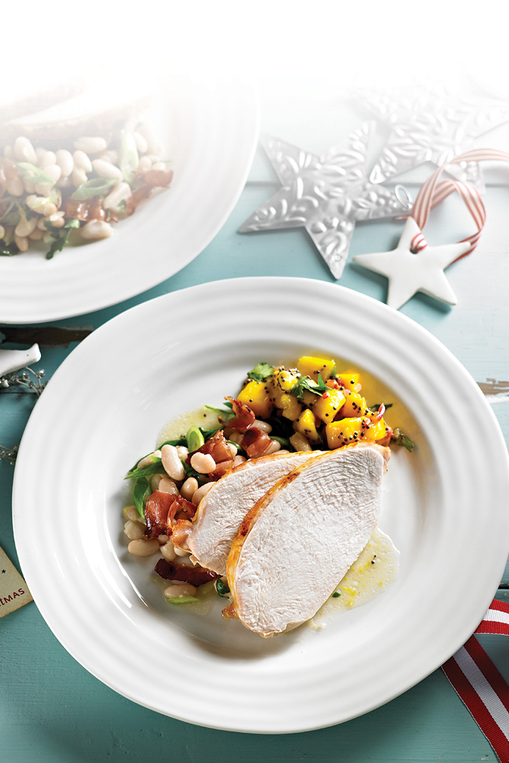 This easy barbecued turkey breast with beans, pancetta and spiced mango chutney recipe is the perfect Christmas main meal idea.