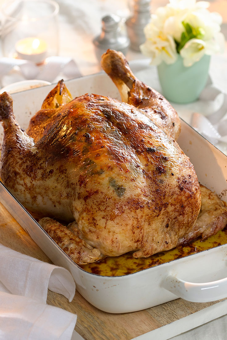 This easy roast chicken with shallots, oregano and lemon butter recipe is a easy chicken dish to serve on Christmas Day.
