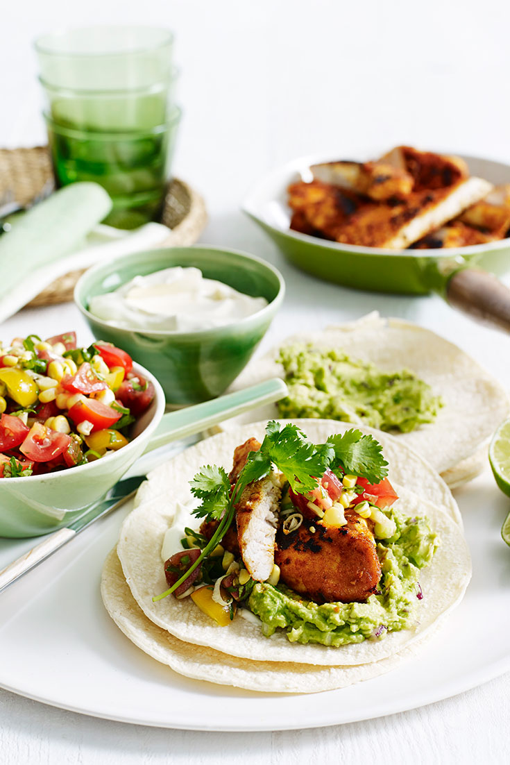 This easy chicken tacos with tomato salsa and guacamole recipe is a great family dinner idea for under 30 minutes.