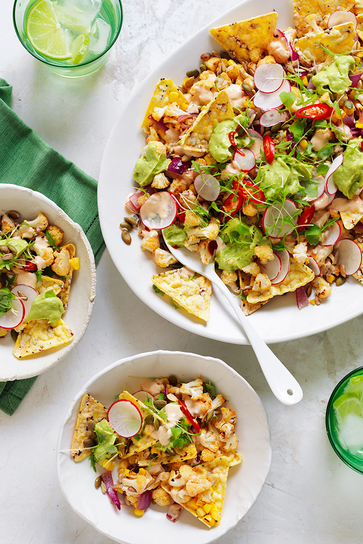 This easy vegetarian chilli and lime roasted cauliflower nachos recipe is perfect for entertaining.