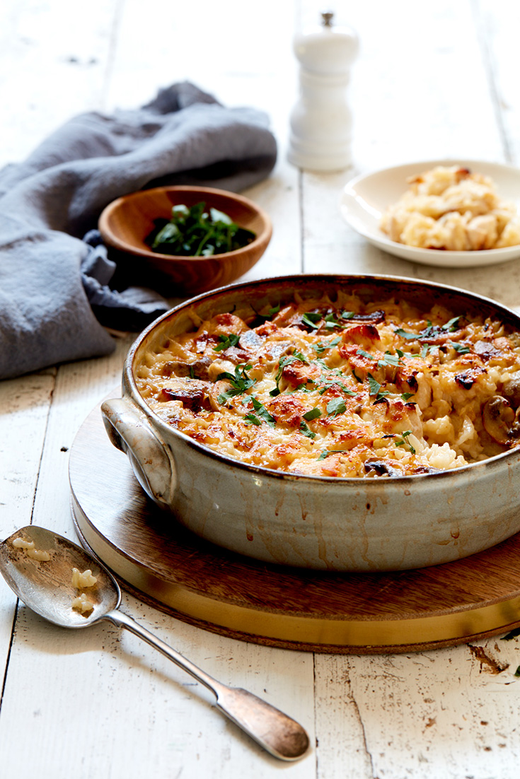 This warming chicken and mushroom baked risotto is a fulfilling family dinner idea.