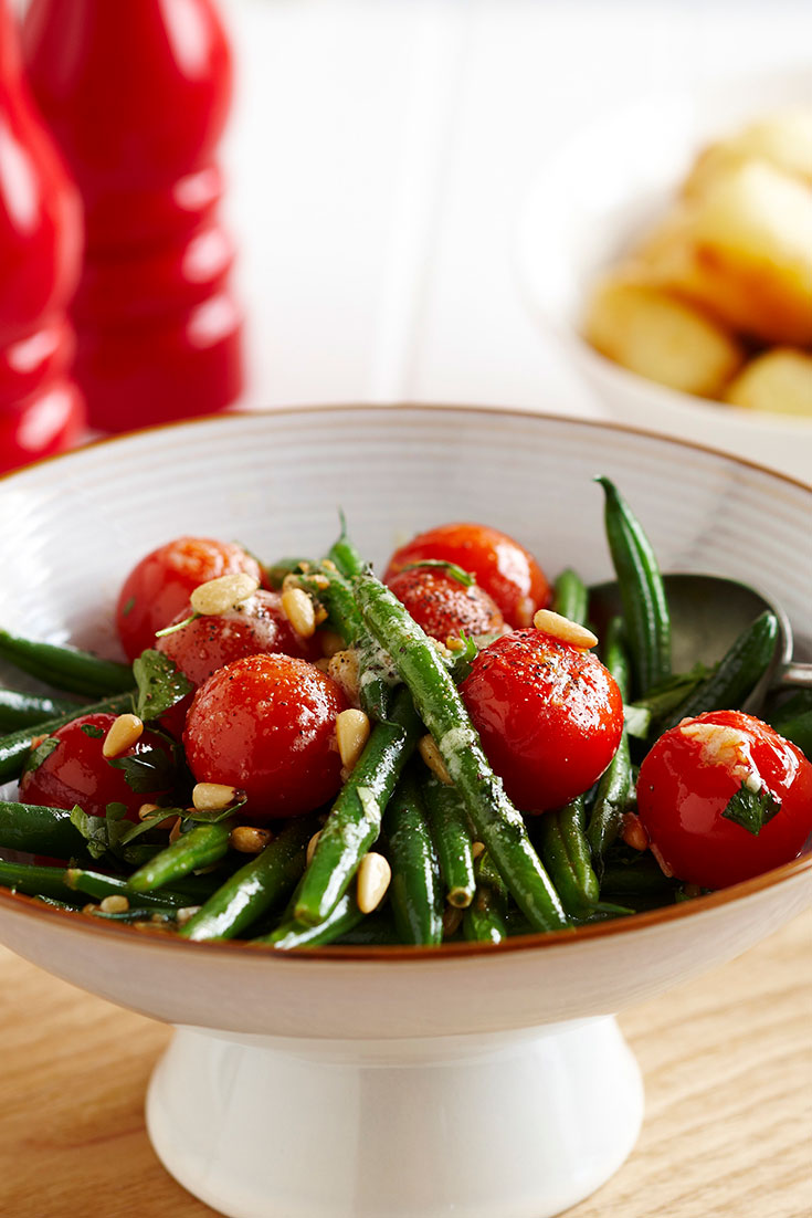 This quick and easy beans and cherry tomatoes with pine nut butter recipe is a flavoursome side dish perfect for midweek dinners.