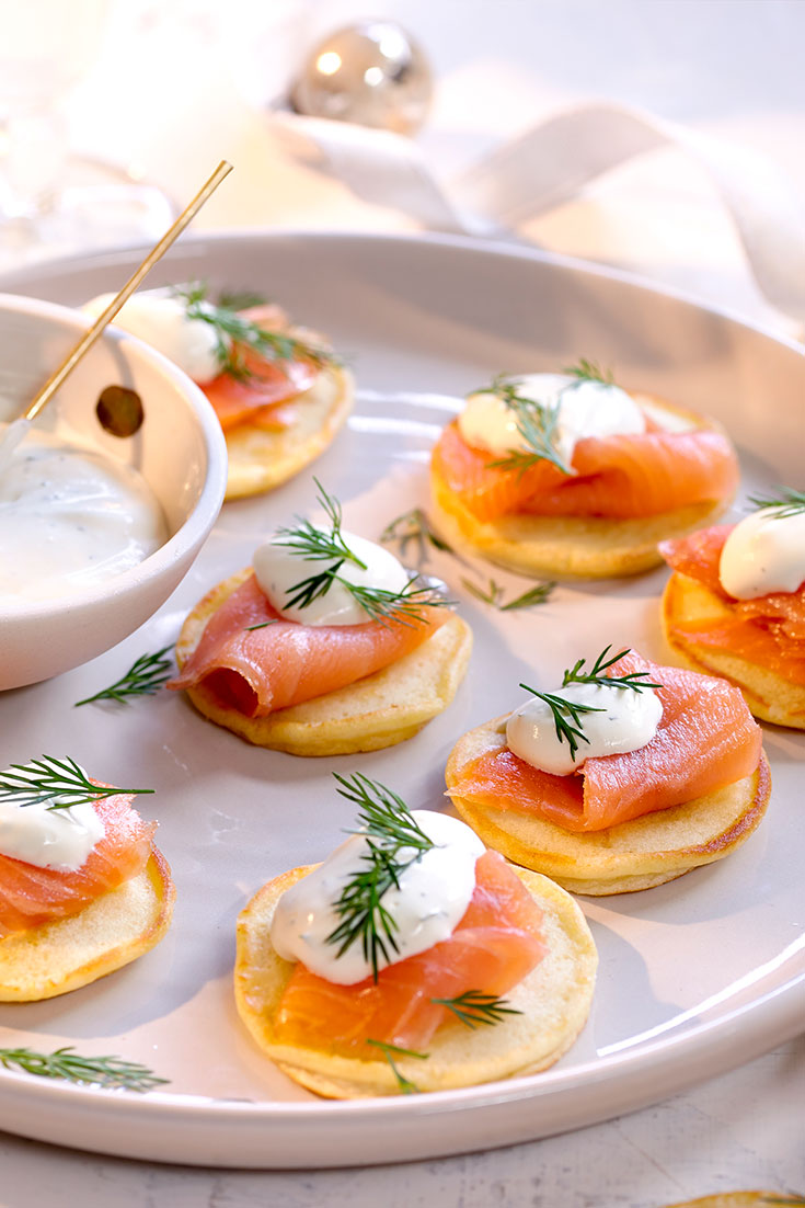 This easy blinis with smoked salmon and dill creme fraiche recipe is the ideal Easter appetiser to keep guests satisfied.