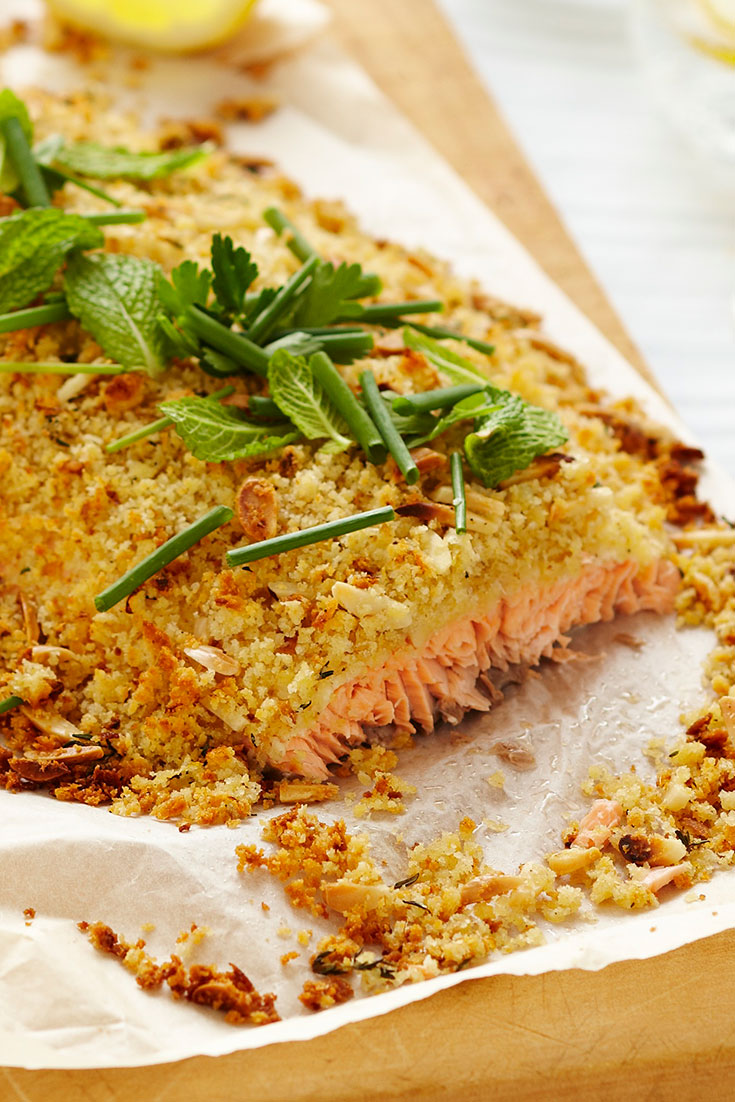 This stunning whole Atlantic salmon fillet with almond, thyme and lemon crust recipe is an ideal dish to serve to a crowd on Easter Friday.