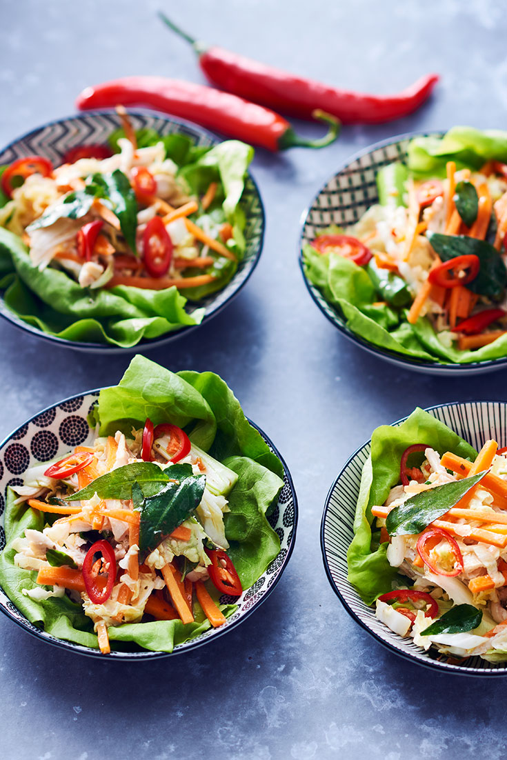 This quick and easy asian poached chicken in lettuce cups is a great low carb dinner option for the whole family.