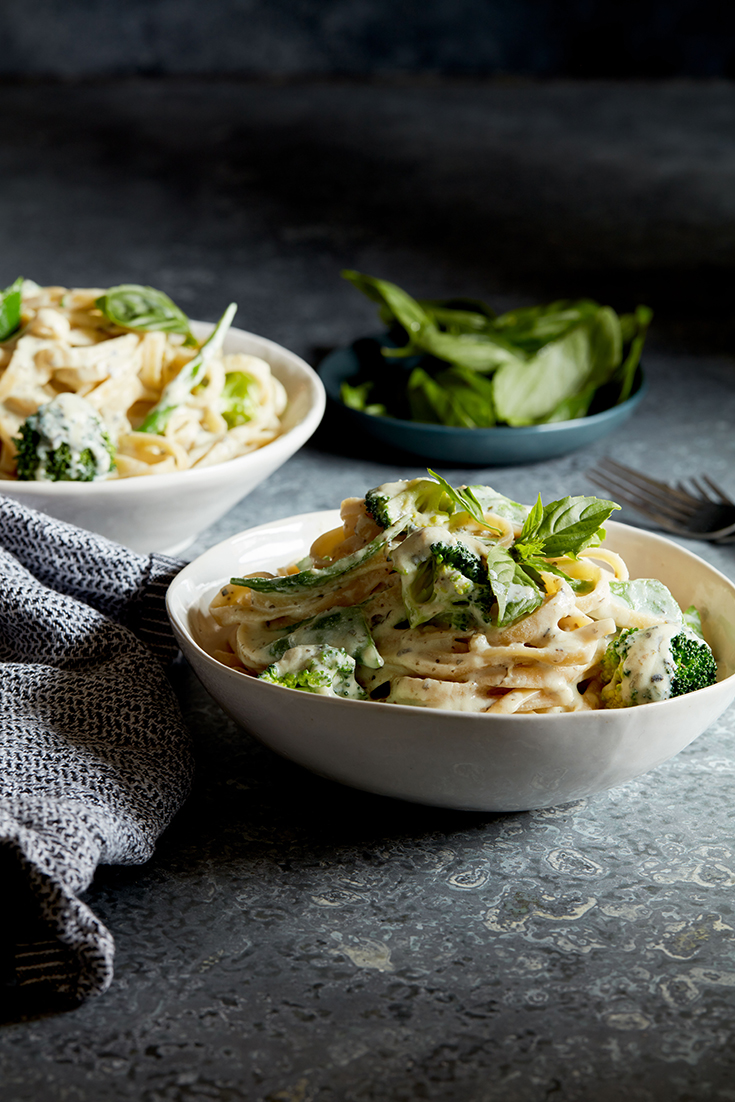 This easy broccoli and snow pear fettuccine with garlic and herb ricotta recipe is a quick and easy vegetarian pasta dish.