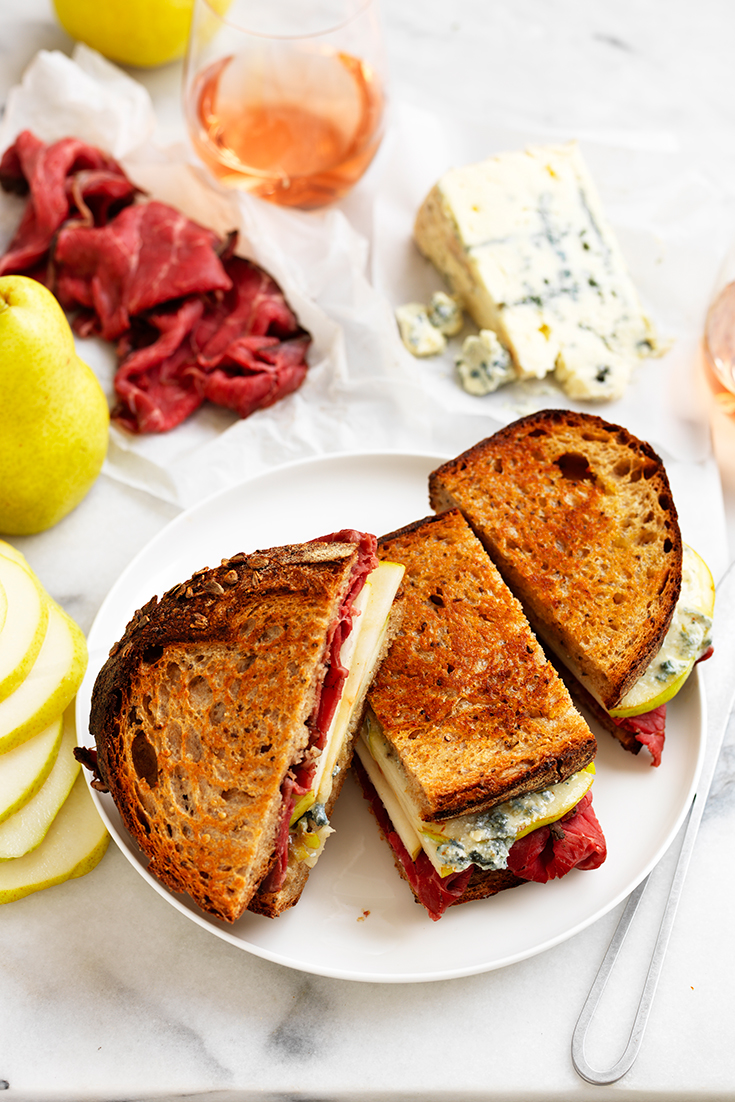 This hearty rare roast beef, pear and creamy blue cheese toasties recipe makes for a great fuss-free family dinner idea.