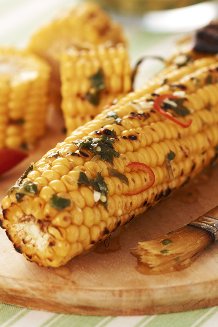 This easy barbecued corn with coriander and chilli butter is a tasty side dish that is great for winter dinners.
