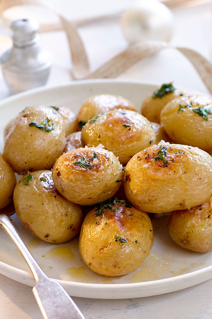 This simple yet flavoursome buttery herb roasted potatoes recipe is the ultimate winter side dish to feed a family.
