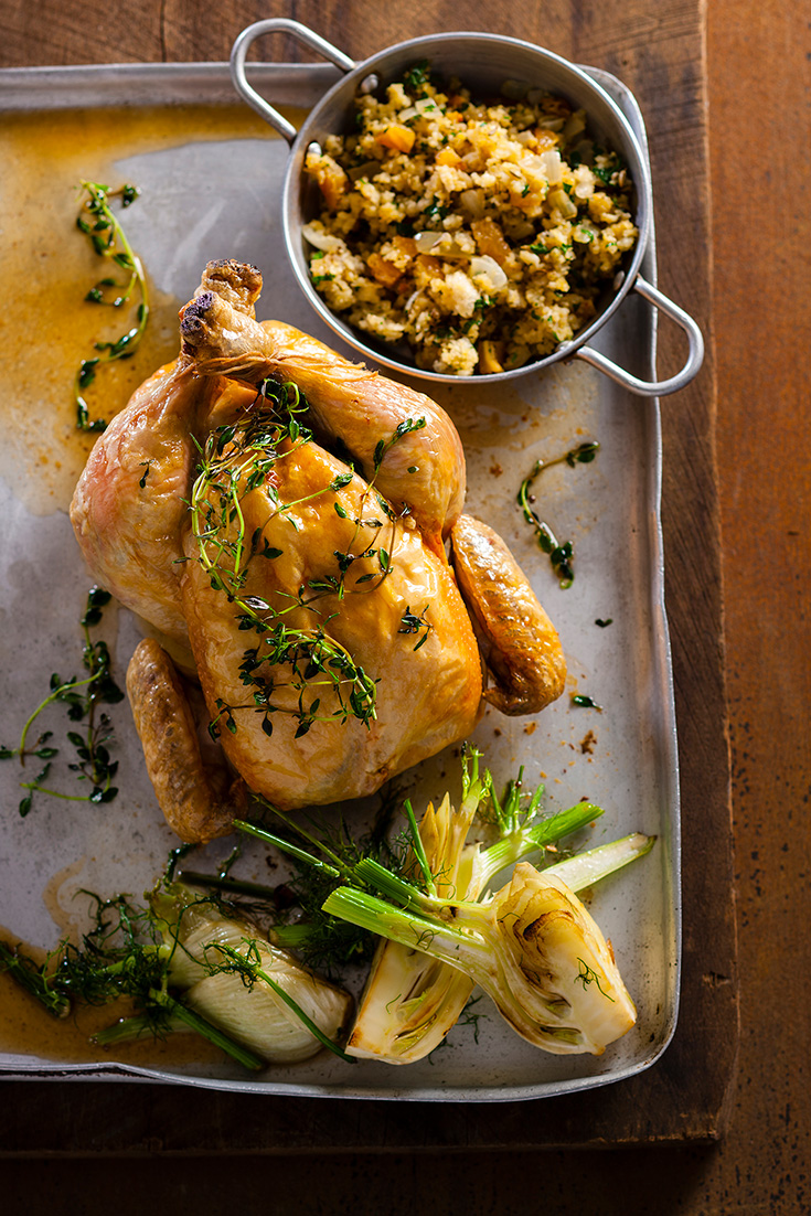 This flavoursome roast chicken with pear lemon and fennel seed stuffing recipe is great for family dinners and Christmas.