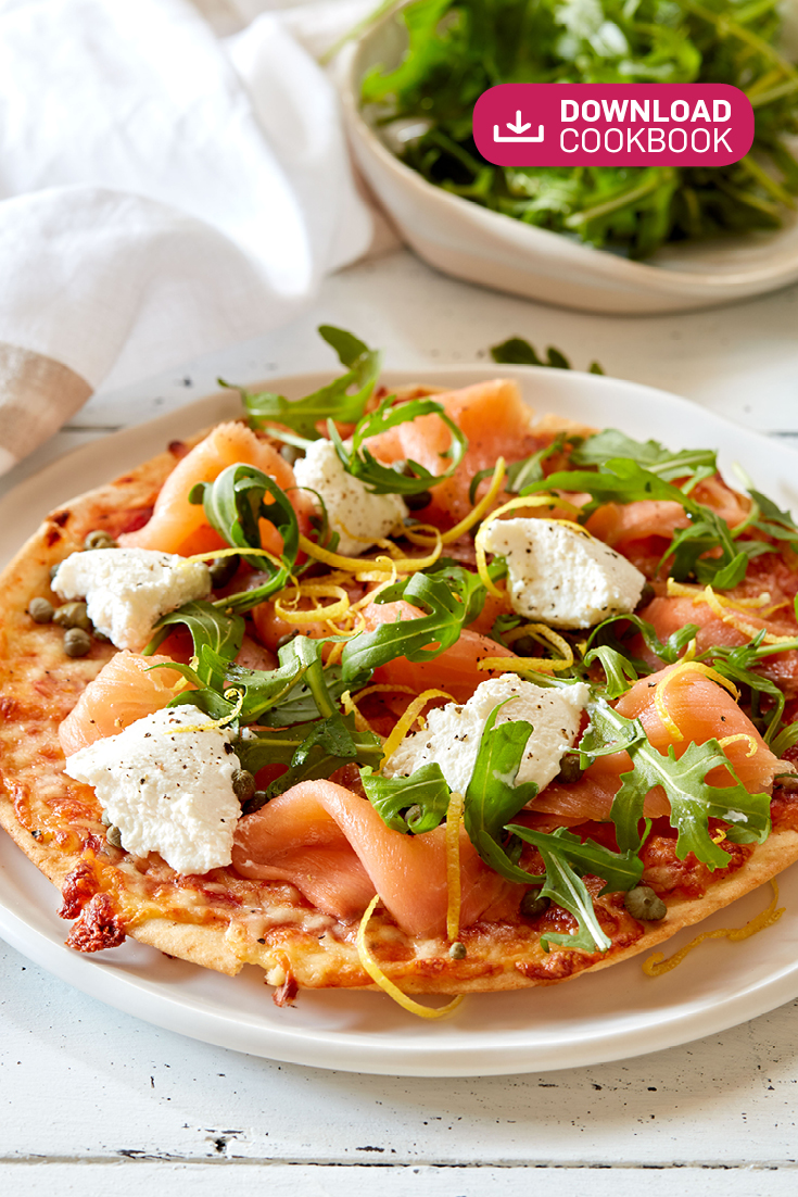 This easy smoked salmon, ricotta and rocket pita pizza recipe is the perfect idea for casual get togethers with friend. Great for feeding a crowd.