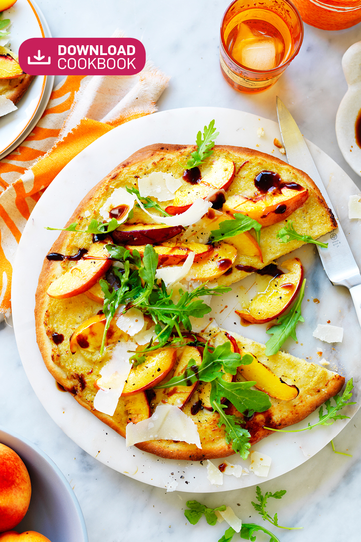 This colourful yellow nectarine, artichoke and rocket pizza is great for feeding hungry guests.