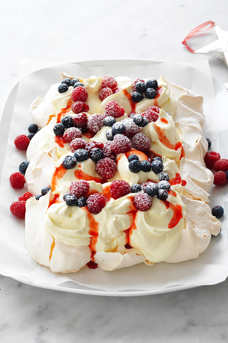 This simple but delicious berries and cream tray pavlova is a wonderful dessert to pair with fresh blueberries.