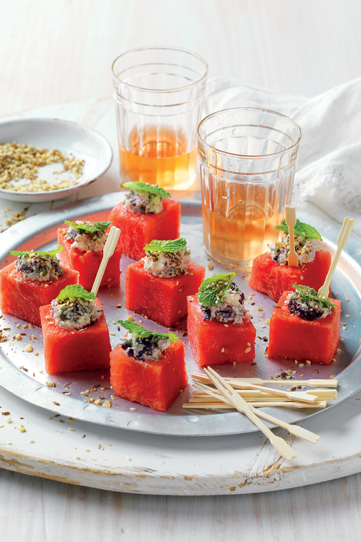 These easy watermelon cubes with feta, olives and mint make for a refreshing appetiser to treat guests too during hot summer nights.