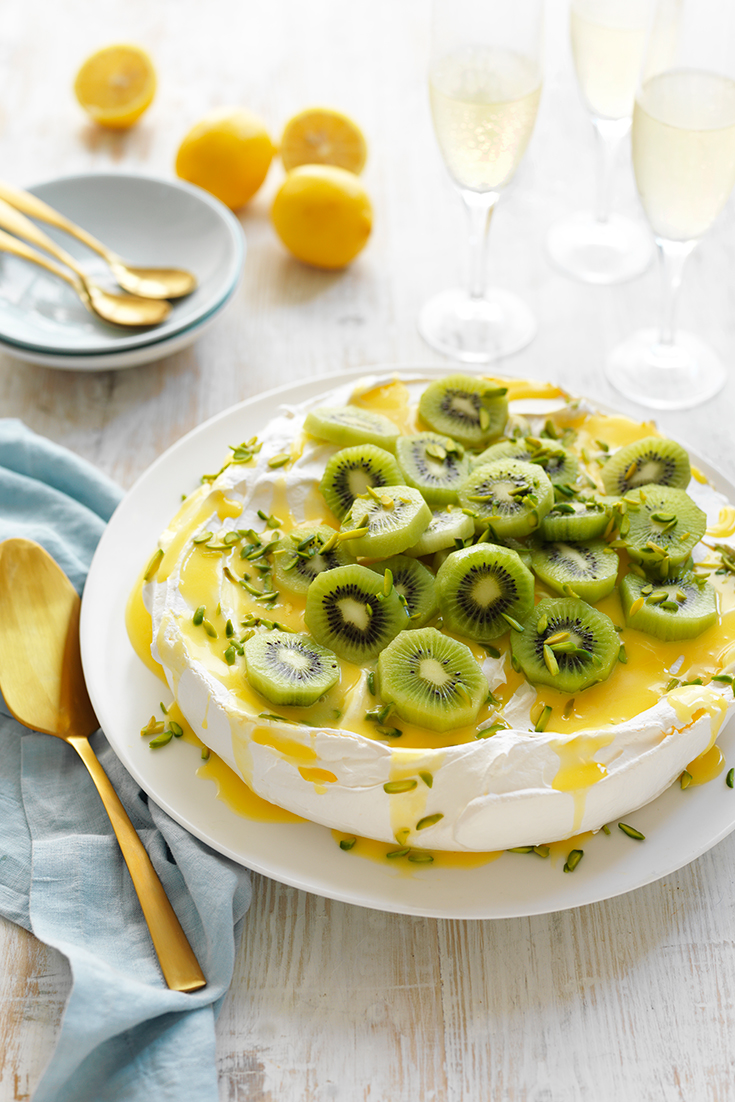This stunning classic pavlova recipe with lemon curd and kiwi fruit is the perfect festive dessert for any occasion.