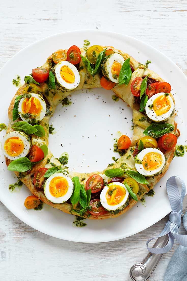 This easy herbed ricotta pastry wreath with pesto eggs recipe is a wonderful Christmas breakfast recipe or enjoy it as one of your mains on Christmas Day.