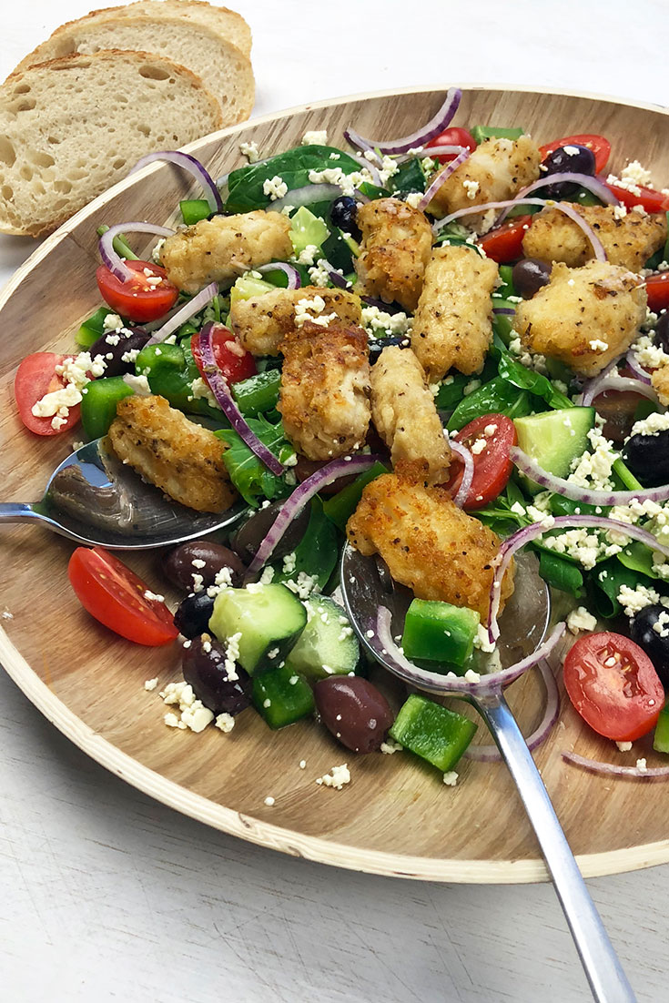 This easy salt and pepper squid with greek salad recipe is a great dish to share around the table.